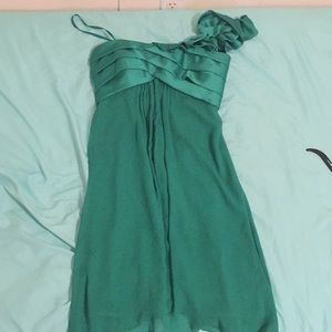 A kind of dark green dress.